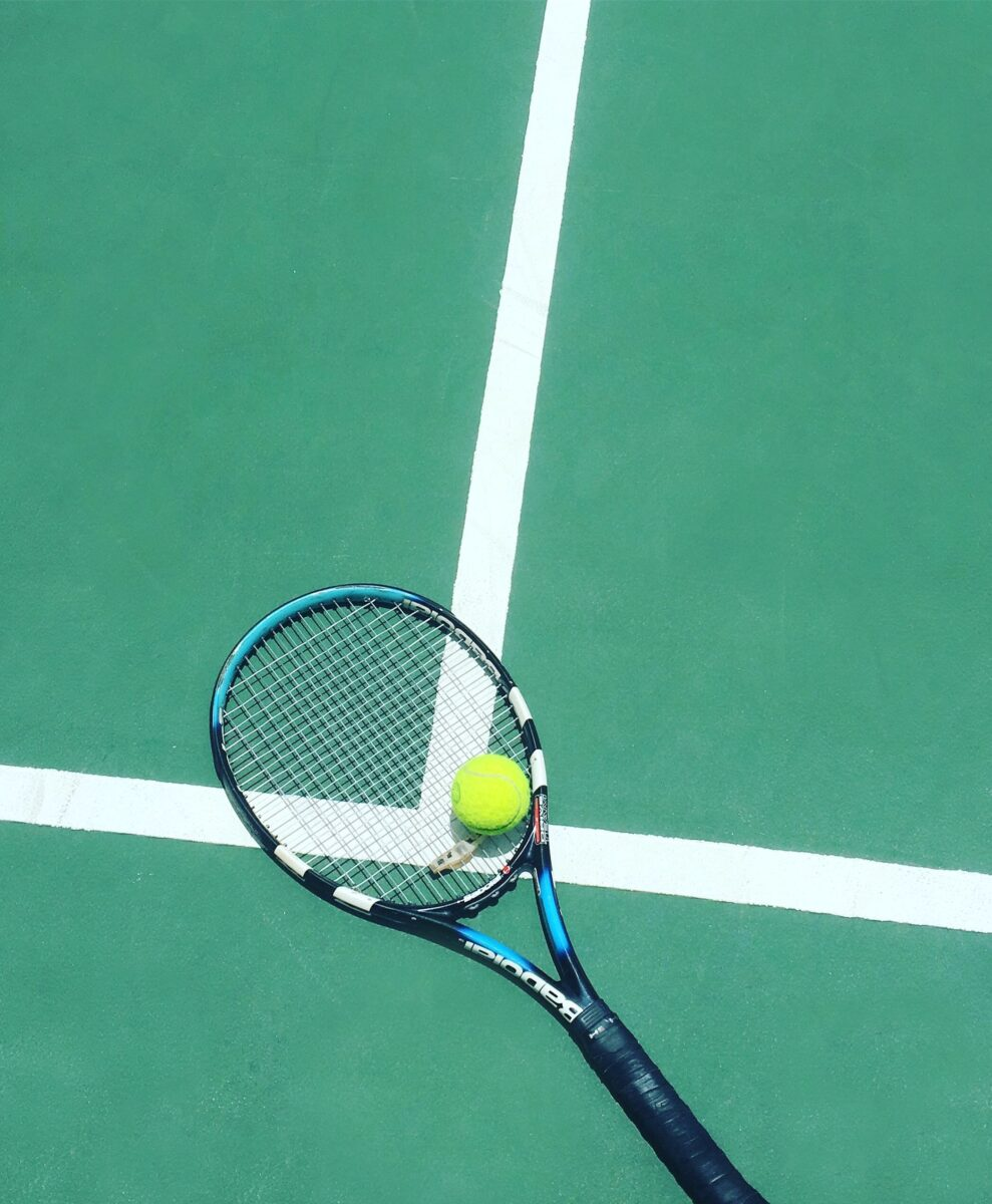 tennis racket and ball on field